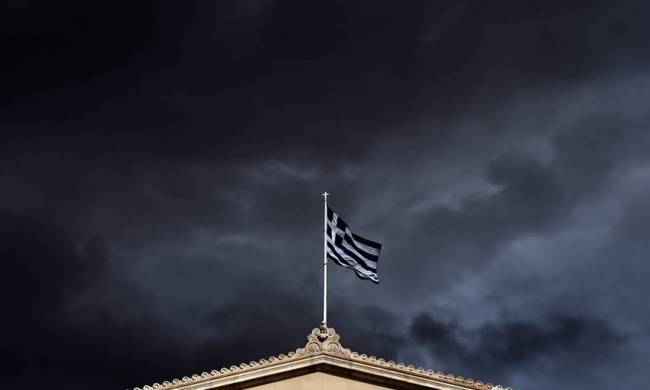 702849-storm-clouds-gather-over-greek-greece-flag-getty-fullsize.jpg
