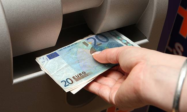723275-euro-hand-taking-cash-from-atm-colour-2.jpg